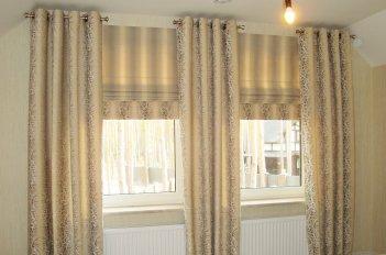Римские шторы и шторы на люверсах в спальне